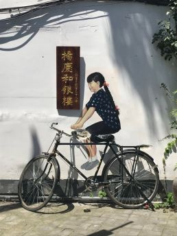 Street art girl on bike.jpg